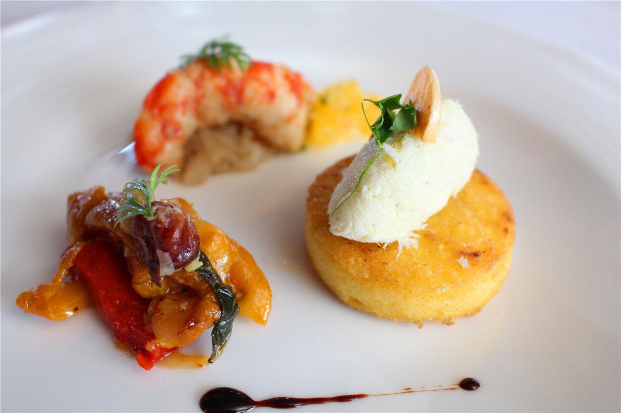 Shrimp with onion, nuts and dried grapes, cod fish mousse with roasted polenta and red pepper compost